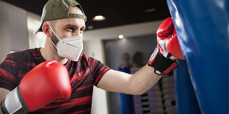 Man boxing with face mask on